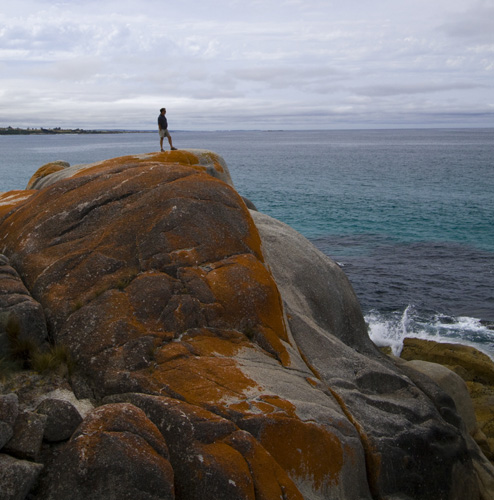 Greg standing on the rocks at Bay of Fires
