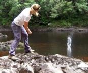 Lisa skimming rocks on the Frankland River