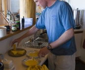 Grant making his famous deep-fried camembert wedges