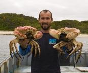 Sam holding  couple of Giant Crab
