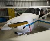 Lisa in the cockpit of Grant\'s ultralight Jabiru plane