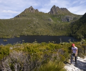 Lisa hiking around Dove Lake with Cradle Mountain in the background