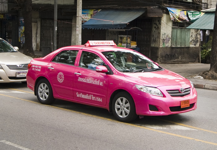A typical pink taxi in Bangkok