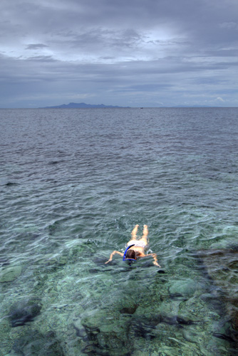 Lisa snorkeling at Cape Jeda Gang with Ko Phangan in the distance