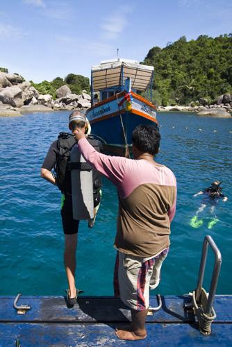Sam getting in the water at Hin Wong Bay