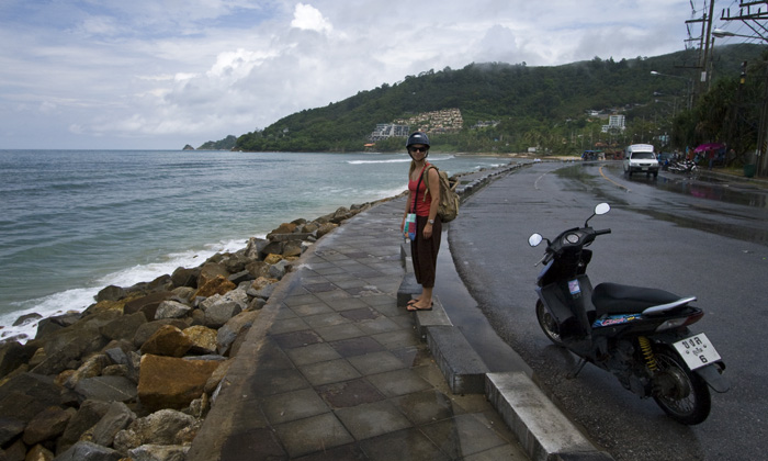Lisa taking a rest next to our moped on our ride along the northwest coast of Phuket