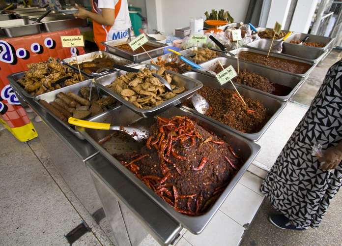 Some spicy-looking food at one of the stalls lining the streets in the old section of Phuket Town