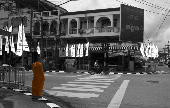 A monk walking the streets of Phuket Town