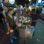 Lisa ordering a roti from one of the vendors on Khaosan Road