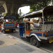 Tuk-tuks line up near King Rama VIII Bridge