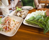 Typical lunch fare for us whilst on Phuket: spicy papaya salad, BBQ chicken, sticky rice and fresh greens