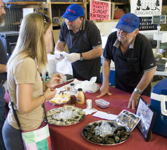 Lisa talking to one of the oyster merchants at the Boat Shed Markets