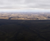 Panoramic of the northern side of Stirling Range National Park and the wheat fields beyond from the top of Bluff Knoll