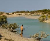 Sam fishing in Cootenbrand Creek at Cape Keraudren