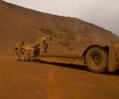 An empty sled next to a regular truck at Tom Price mine