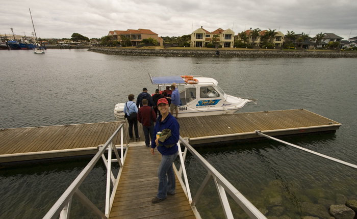 Lisa walking to the boat for a tour of some of the Port Lincoln fish farms