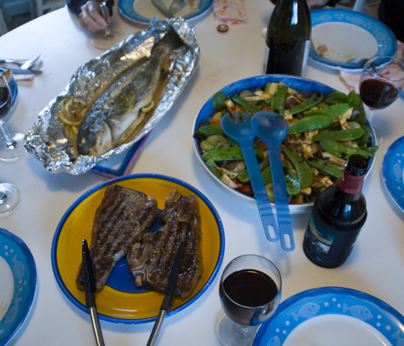 Fresh fish, salad and some good-looking steaks for dinner