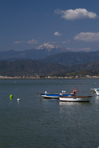 Fishing boats in Fethiye Bay with snow-capped peaks in the distance