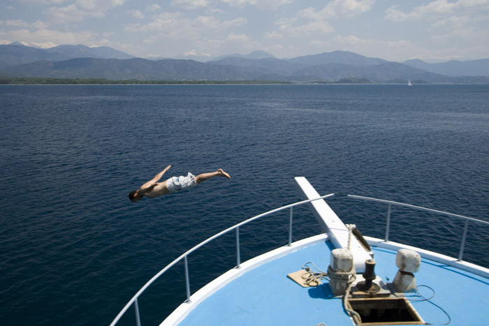 Sam diving off the boat for a dip in the Mediterranean