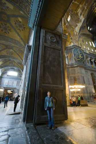 Lisa standing in front of the gigantic Imperial Door separating Aya Sofya's main dome from the inner narthex