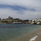 View of the Bodrum castle and beachfront restaurants in the eastern bay