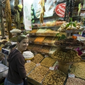 Lisa in front of dried fruits and nuts in the Spice Bazaar