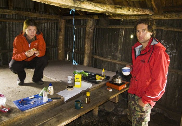 Lisa and Chris sheltering themselves for lunch in the Howitt Plains Hut