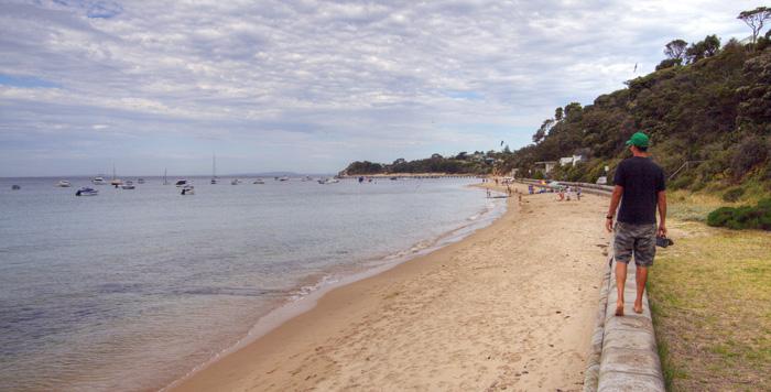 Sam walking along the beach in Portsea
