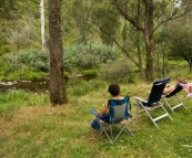 Chris and Lisa relaxing by the Howqua River at Noonans Flat