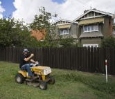 Sam helping with the yard work at the Detmold house in Echuca