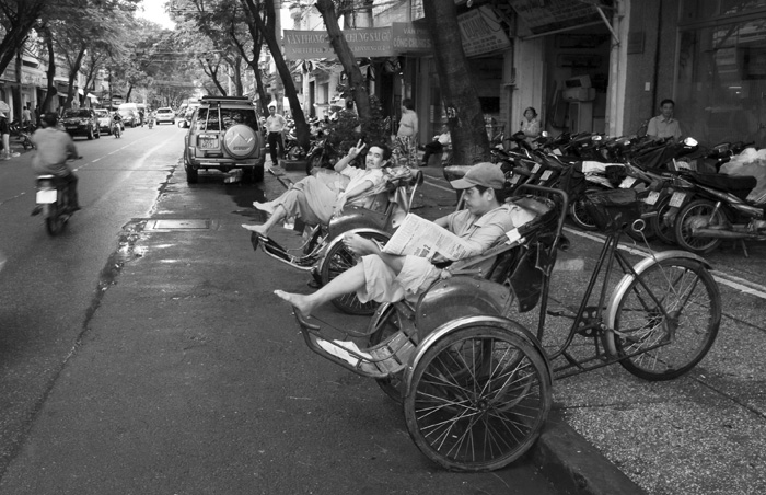 Cyclo drivers waiting out the mid-afternoon rain