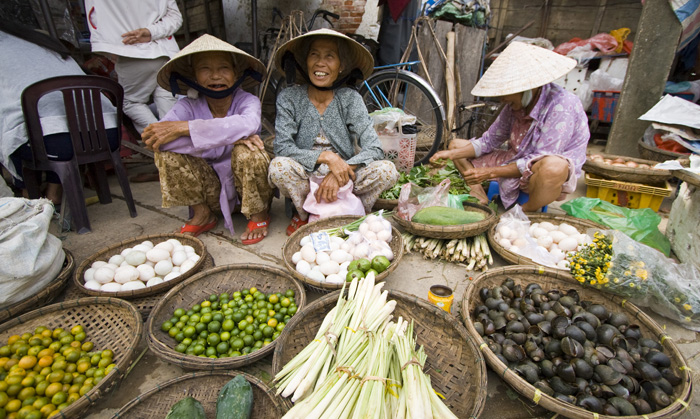 Locals peddling their wares in Hoi An\'s central market