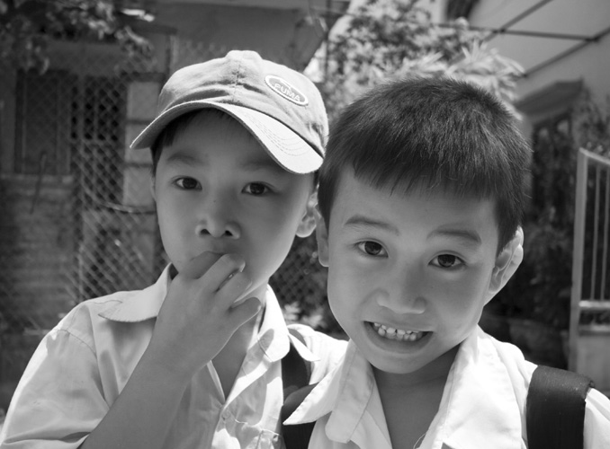 School boys on their way home in Hoi An
