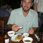 Sam enjoying some barbequed prawns