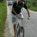 Sam on his bike riding between Hoi An and the beach