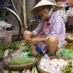 Locals peddling their wares in Hoi An's central market