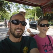 Sam and Lisa in a cyclo taking a tour across Hanoi