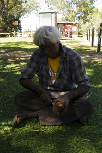 A local carving Boab nuts in Fitzroy Crossing