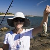 Lisa and a small reef fish at McGowan\'s Island