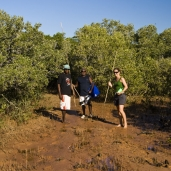 Lisa with two of the Aboriginal fellows from Gambanan on the way through the mangroves