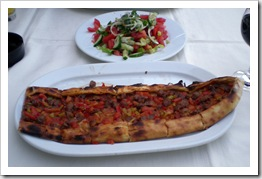 A beef pide and green salad