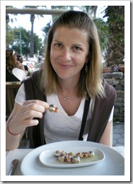 Lisa enjoying on of her favorite mezes: olives wrapped in anchovies