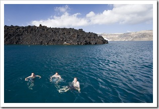 Squino, ET and Pete swimming off of Nea Kameni with Santorini in the background