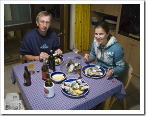 John (with his eyes shut!) and Lisa enjoying oysters for dinner
