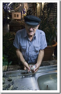 The oyster shucker at Yots Greek Taverna