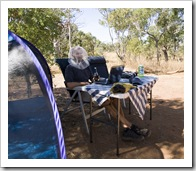 Sam having an afternoon beer and working on the blog in his fly net