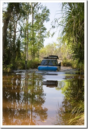 A Land Rover crossing the creek on the road into Tjaynera Falls