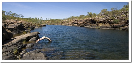 Lisa diving into the swimming hole at the top of Mitchell Falls