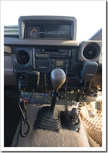 Bottom right is the HF radio control unit, underneath the car stereo is the UHF radio transceiver and up top is the auxillary fuel tank gauge