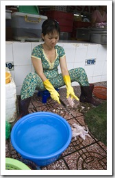 Skinning fresh frogs in Ben Tanh Market